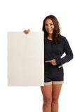 Smiling Asian Female Pointing to a Blank Board Royalty Free Stock Photo