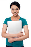 Smiling asian female posing with laptop Stock Images