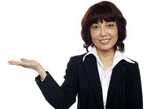 Smiling asian female presenting copy space Royalty Free Stock Photo