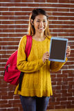 Smiling asian female student showing tablet Stock Image