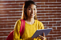 Smiling asian female student using tablet Stock Image