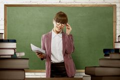 Smiling asian female teacher ready to teach. On the classroom royalty free stock image