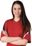 Smiling asian football fan looking at camera Royalty Free Stock Images