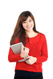 Smiling Asian girl holding a tablet Stock Photos