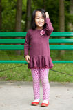 Smiling asian girl in park Royalty Free Stock Images