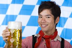 Smiling Asian holds Oktoberfest beer stein (Mass) Stock Images