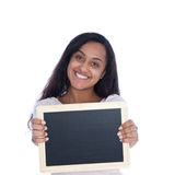 Smiling Asian Indian Woman Holding Empty Board. Close up Smiling Pretty Asian Indian Woman Holding an Empty Black Chalkboard, Emphasizing Copy Space. Isolated on Stock Photo