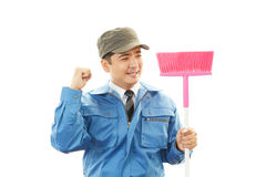 Smiling Asian janitor Royalty Free Stock Image