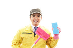 Smiling Asian janitor Stock Photo
