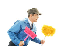 Smiling Asian janitor Stock Images