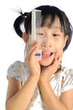 Smiling asian little girl with applying make up baby powder Stock Photography