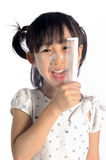 Smiling asian little girl with applying make up baby powder Stock Image