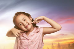 Smiling asian little girl with fun happiness expression Royalty Free Stock Photo