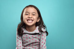 Smiling asian little girl and her broken teeth Royalty Free Stock Images