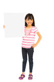 Smiling asian little girl holding blank sign royalty free stock image