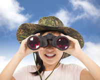 Smiling asian Little girl looking through binoculars Royalty Free Stock Image