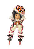 Smiling asian little girl roller skates and protective gear Royalty Free Stock Images