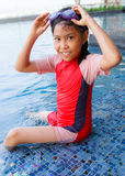 Smiling asian little girl in swimming pool,  Summer outdoor Royalty Free Stock Image