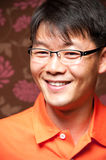 Smiling asian man. Portrait of a smiling Asian man wearing glasses stock images
