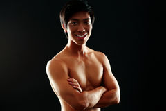 Smiling asian man with arms folded Royalty Free Stock Images