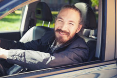 Smiling Asian man as a driver of modern suv Royalty Free Stock Image