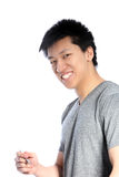 Smiling Asian Man Holding a Pen Stock Photo