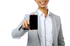 Smiling asian man holding smartphone Royalty Free Stock Photography