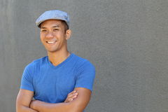Smiling Asian man in newsboy hat.  Stock Photography