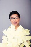 Smiling asian man pasted stickers Stock Photography