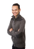 Smiling asian man posing with arms crossed Stock Photo