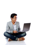 SMiling asian man sitting on the floor Royalty Free Stock Image
