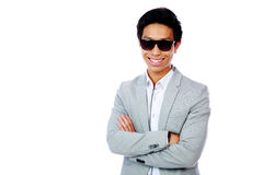 Smiling asian man standing with arms folded Stock Photos