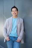 Smiling asian man standing outdoors Royalty Free Stock Photo