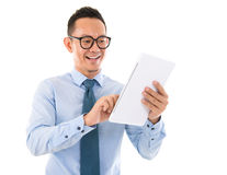 Smiling Asian man with tablet computer Stock Photo