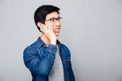 Smiling asian man talking on the phone Stock Images