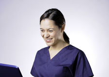 Smiling asian medical assistant. Stock Images