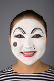Smiling asian mime looking to the camera Royalty Free Stock Image