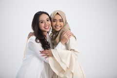 Together with friend. Smiling asian muslim bestfriend in front of camera. eid mubarak concept Royalty Free Stock Photos