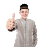 Smiling asian muslim man showing thumb up Stock Photo