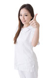 Smiling Asian nurse give an excellent sign Stock Photo