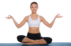 Smiling asian sitting in the lotus position Stock Images