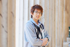 Smiling asian student outdoors royalty free stock photos