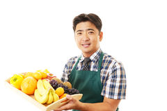 Smiling Asian waiter. Happy waiter represent hospitality - on a white background Royalty Free Stock Images