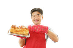 Smiling Asian waiter Stock Images
