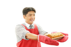 Smiling Asian waiter. Happy young waiter represent hospitality - on a white background Stock Photo