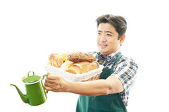 Smiling Asian waiter Royalty Free Stock Image