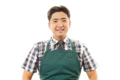 Smiling Asian waiter. Happy young waiter represent hospitality - on a white background Royalty Free Stock Images