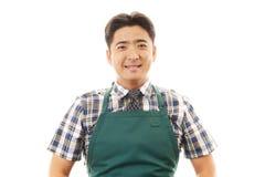Smiling Asian waiter Royalty Free Stock Images