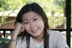 Smiling Asian Woman. Pretty Asian woman strikes a smiling pose Stock Photos