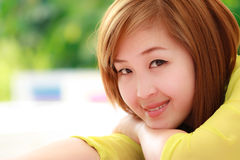 Smiling Asian woman Stock Photography